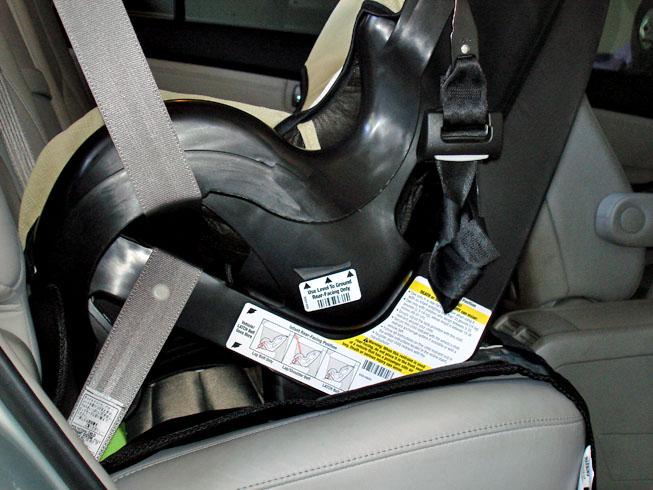 OnboardTM SurefitTM Infant Seat Instruction Manual Eddie Bauer Car