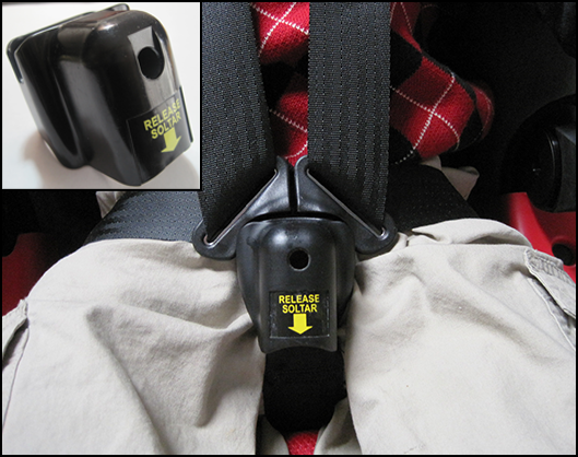 Child Undoing Car Seat Buckle