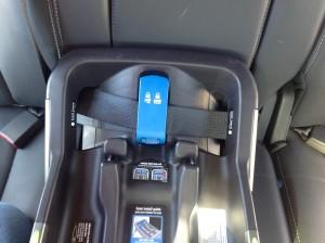 Nuna Pipa installed with seatbelt - lockoff