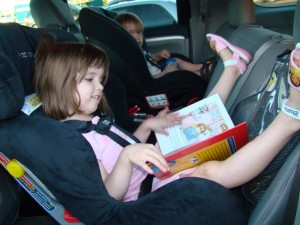 Rear-facing toddlers in TrueFit - reading book