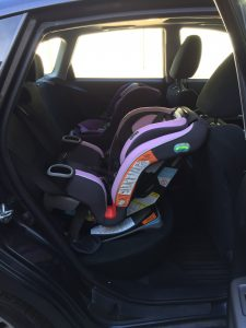 "The Extend2Fit 3-in-1 on the newborn setting in the Impreza. The front seat is adjusted comfortably for a 5'4"" passenger."