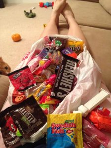 Last year's haul. Kids totally thought I wouldn't sit on the couch and pig out on their candy. Jokes on them! Crispy the cat was the only witness and he never tells.